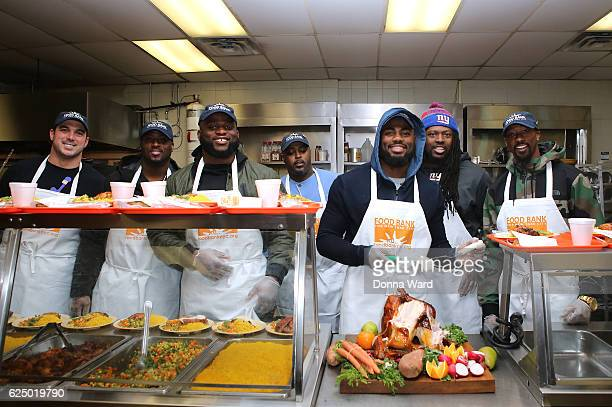 Zak DeOssie Will Johnson Owa Odighdizuwa Landon Collins Tavares King appear to serve at Food Bank for New York City's Community Kitchen of West...