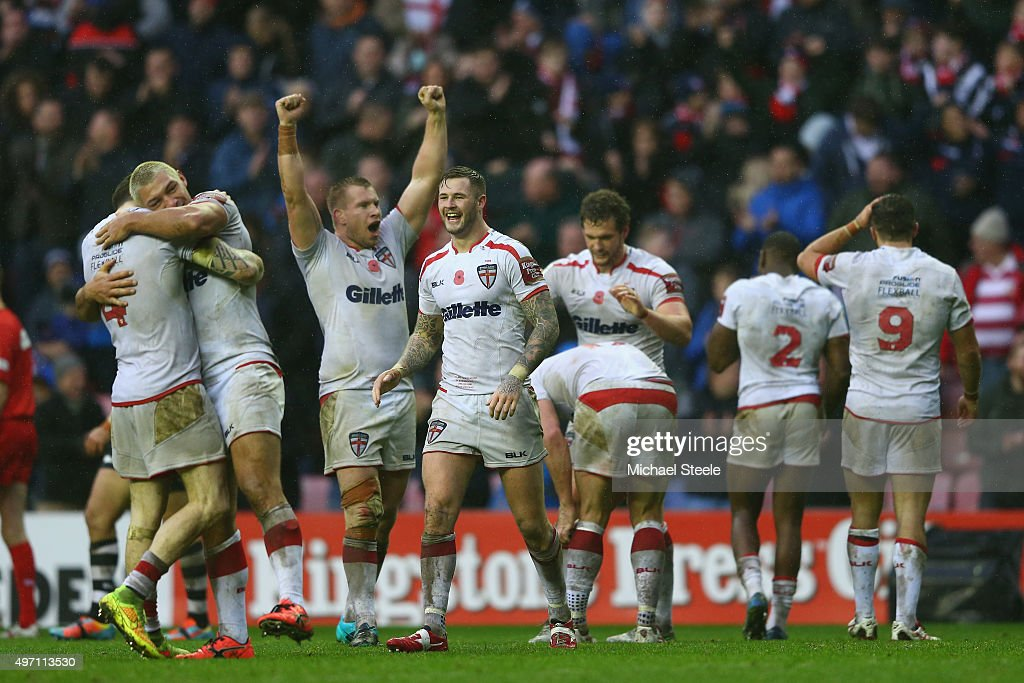 Zak Hardaker (C) celebrates alongside team mates at the final whistle after clinching the series 2-1 with a 20-14 victory during the third International Rugby League Test Series match between England and New Zealand at DW Stadium on November 14, 2015 in Wigan, England.