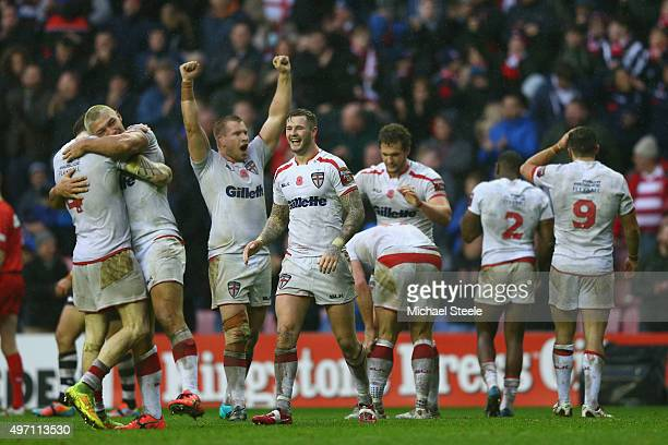 Zak Hardaker celebrates alongside team mates at the final whistle after clinching the series 21 with a 2014 victory during the third International...