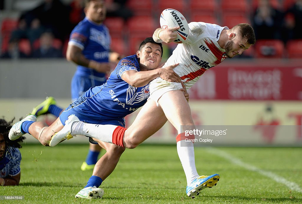Zak Hardaker of England Knights is tackled by Anthony Milford of Samoa during the International match between England Knights and Samoa at Salford City Stadium on October 19, 2013 in Salford, England.