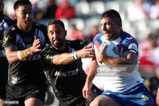 Zak Hardaker of Great Britain fends Benji Marshall of the Kiwis during the International Rugby League Test Match between the New Zealand Kiwis and...