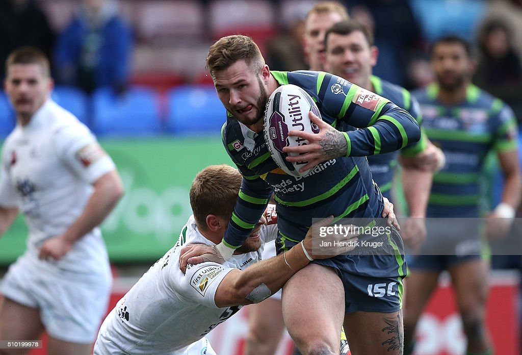 Zak Hardaker of Leeds Rhinos is tackled by Rhys Hanbury of Widnes Vikings during the First Utility Super League match between Widnes Vikings and Leeds Rhinos at Select Security Stadium on February 14, 2016 in Widnes, England.