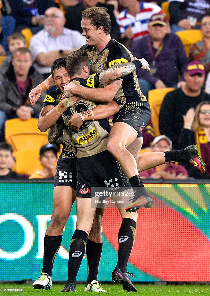 Zak Hardaker of the Panthers is congratulated by team mates after scoring a try during the round 20 NRL match between the Brisbane Broncos and the Penrith Panthers at Suncorp Stadium on July 22, 2016 in Brisbane, Australia.
