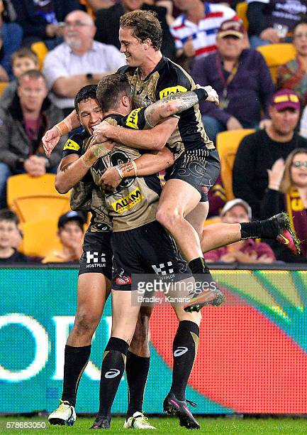 Zak Hardaker of the Panthers is congratulated by team mates after scoring a try during the round 20 NRL match between the Brisbane Broncos and the...