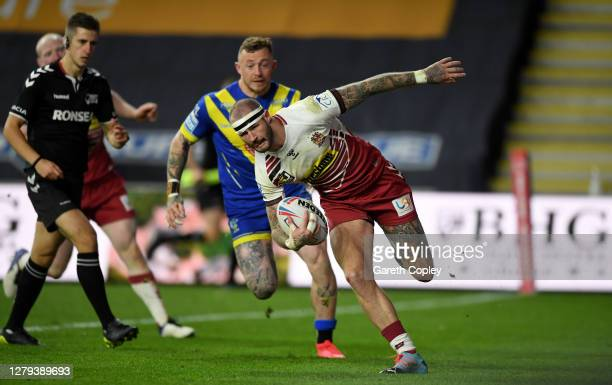 Zak Hardaker of Wigan scores a second half try during the Betfred Super League match between Warrington Wolves and Wigan Warriors at Emerald...