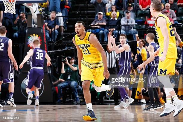 Zak Irvin of the Michigan Wolverines celebrates hitting the gamewinning shot against the Northwestern Wildcats in the second round of the Big Ten...