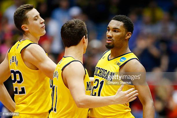Zak Irvin of the Michigan Wolverines celebrates with teammates in the second half against the Tulsa Golden Hurricane during the first round of the...