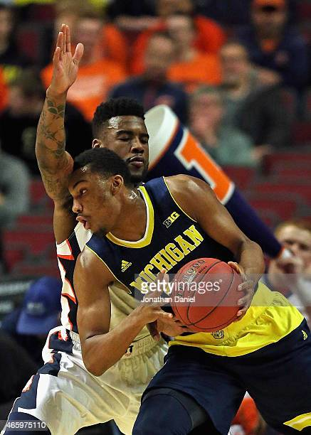 Zak Irvin of the Michigan Wolverines moves against Rayvonte Rice of the Illinois Fighting Illini during the second round of the 2015 Big Ten Men's...