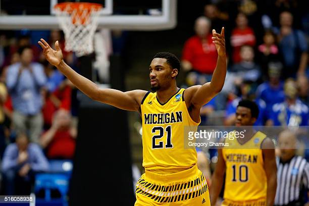 Zak Irvin of the Michigan Wolverines reacts in the second half against the Tulsa Golden Hurricane during the first round of the 2016 NCAA Men's...
