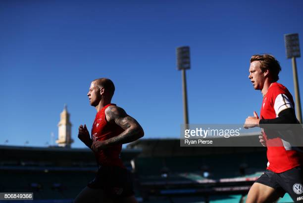 Zak Jones and Callum Mills of the Swans run laps during a Sydney Swans AFL training session at Sydney Cricket Ground on July 4 2017 in Sydney...
