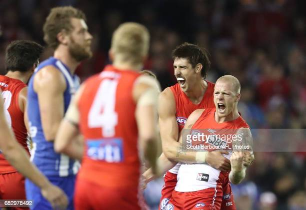 Zak Jones of the Swans celebrates after kicking a goal with Sam Naismith of the Swans during the round eight AFL match between the North Melbourne...