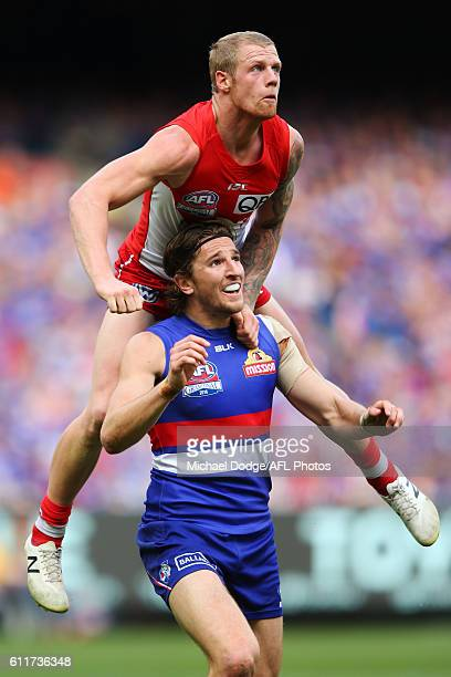Zak Jones of the Swans competes for the ball over Marcus Bontempelli of the Bulldogs during the 2016 AFL Grand Final match between the Sydney Swans...