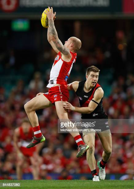Zak Jones of the Swans marks the ball over Zach Merrett of the Bombers during the AFL Second Elimination Final match between the Sydney Swans and the...