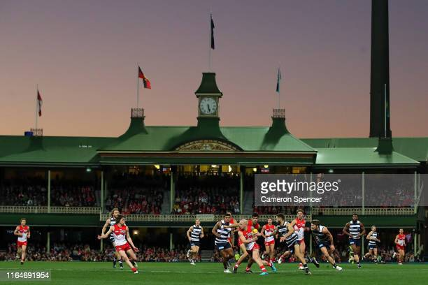 Zak Jones of the Swans runs the ball during the round 19 AFL match between the Sydney Swans and the Geelong Cats at Sydney Cricket Ground on July 28,...