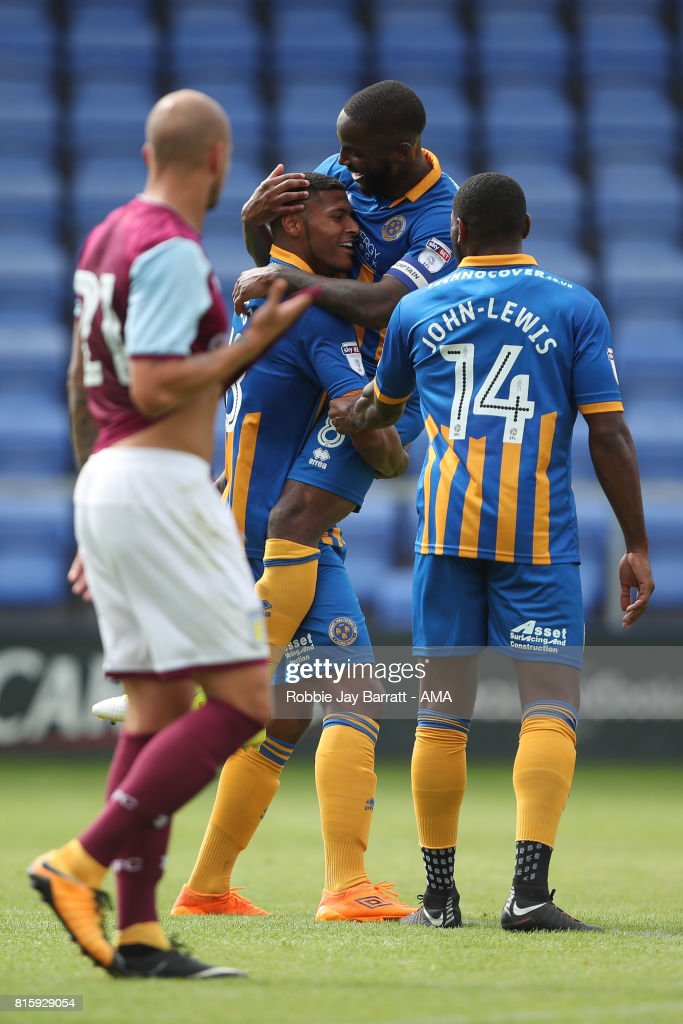 Zak Jules of Shrewsbury Town celebrates after scoring a goal to make it 1-0 during the pre-season friendly match between Shrewsbury Town and Aston Villa at Greenhous Meadow on July 15, 2017 in Shrewsbury, England.