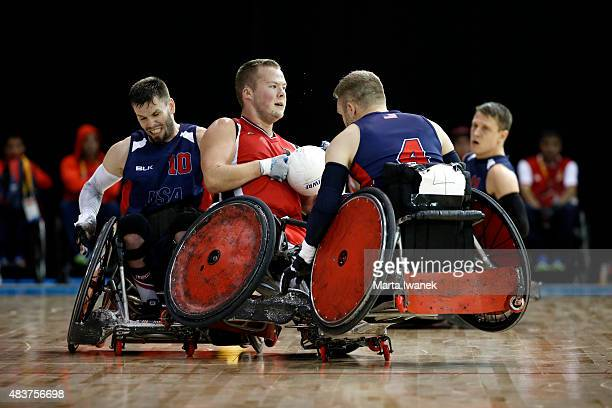 AUGUST 12 Zak Madell of Canada faces off with Josh Wheeler and Adam Scaturro of USA during the Wheelchair Rugby game between Canada and the USA...