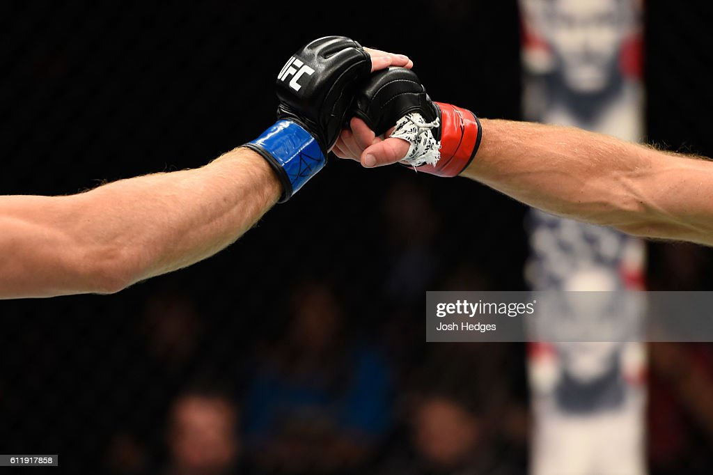 Zak Ottow and Joshua Burkman touch gloves in their welterweight bout during the UFC Fight Night event at the Moda Center on October 1, 2016 in Portland, Oregon.