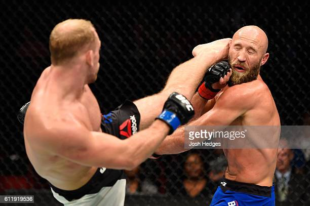 Zak Ottow lands a head kick against Joshua Burkman in their welterweight bout during the UFC Fight Night event at the Moda Center on October 1 2016...