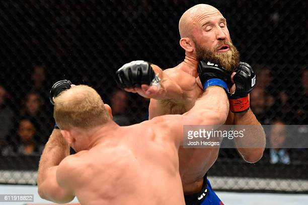 Zak Ottow punches Joshua Burkman in their welterweight bout during the UFC Fight Night event at the Moda Center on October 1 2016 in Portland Oregon