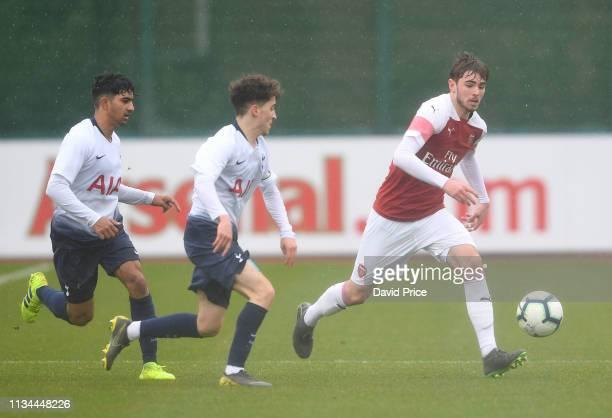 Zak Swanson of Arsenal takes on Armando Shashoua and Dilan Kumar Markanday of Tottenham during the match between Arsenal U18 and Tottenham Hotspur...