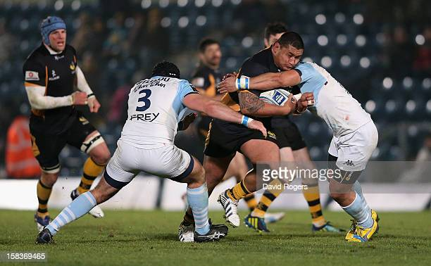 Zak Taulafo of Wasps is tackled during the Amlin Challenge Cup match between London Wasps and Bayonne at Adams Park on December 13 2012 in High...
