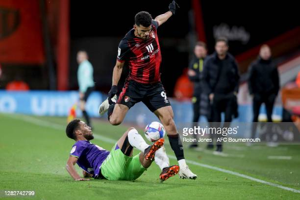 Zak Vyner of Bristol City slides in to stop Dominic Solanke of Bournemouth during the Sky Bet Championship match between AFC Bournemouth and Bristol...