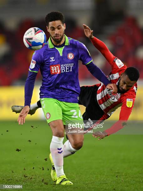Zak Vyner of Bristol City tackles Rico Henry of Brentford during the Sky Bet Championship match between Brentford and Bristol City at Brentford...