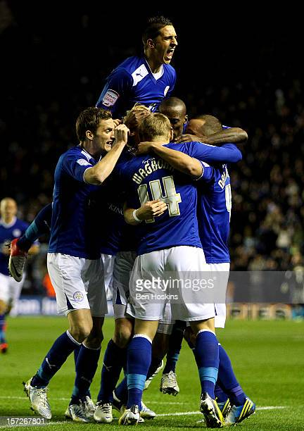 Zak Whitbread of Leicester is mobbed by team mates after scoring the opening goal of the game during the npower Championship match between Leicester...