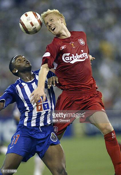 Zak Whitbread of Liverpool FC heads the ball over Benni McCarthy of FC Porto during their Championsworld Series match July 30 2004 at Skydome in...