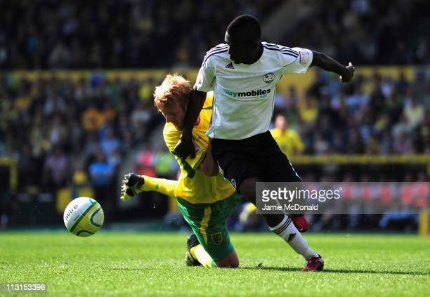 Zak Whitbread of Norwich City battles with Theo Robinson of Derby County during the npower Championship match between Norwich City and Derby County...