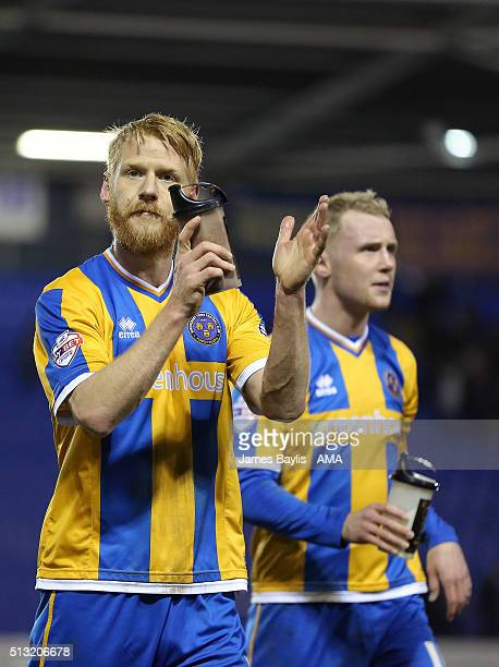 Zak Whitbread of Shrewsbury Town applauds the fans at full time of the Sky Bet League One match between Shrewsbury Town and Rochdale at New Meadow on...