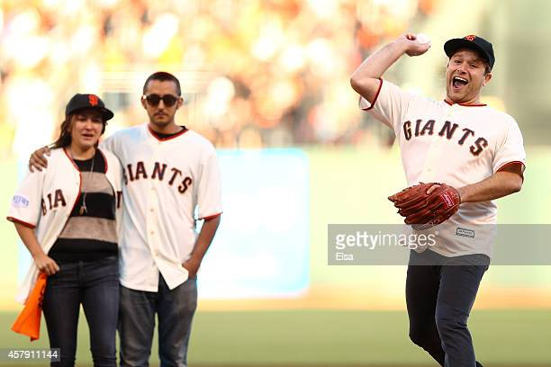Zak Williams son of Robin Williams throws out the ceremonial first pitch as Zelda and Cody Williams look on before Game Five of the 2014 World Series...