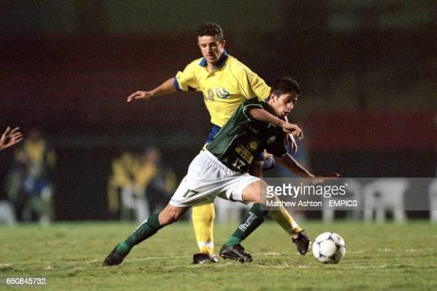 Zakaria Aboub of Raja Casablanca gets past AlNassr's Moussa Saib