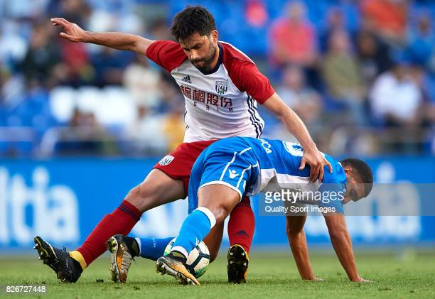 Zakaria Bakkali of Deportivo de La Coruna is challenged by Claudio Yacob of West Bromwich Albion during the Pre Season Friendly match between...