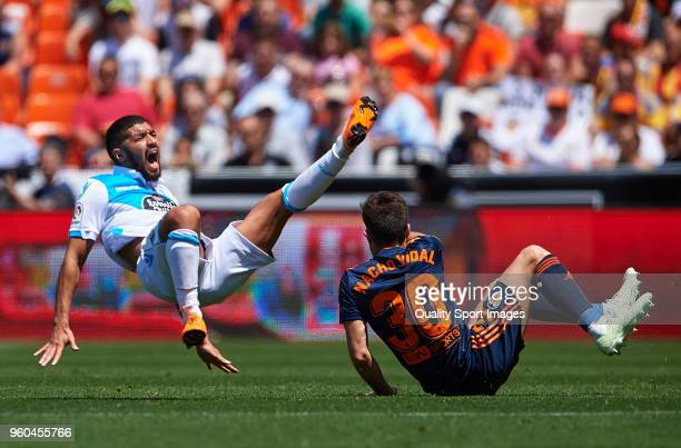 Zakaria Bakkali of Deportivo de La Coruna is tackled by Nacho Vidal of Valencia during the La Liga match between Valencia and Deportivo La Coruna at...