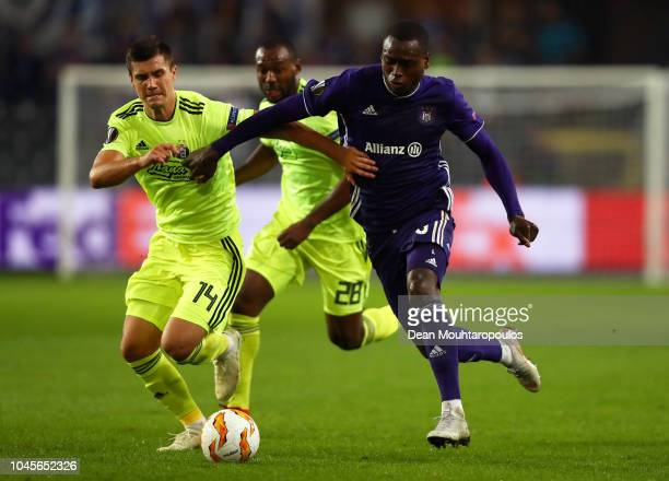 Zakaria Bakkali of RSC Anderlecht battles for possession with Amer Gojak of Dinamo Zagreb during the UEFA Europa League Group D match between RSC...