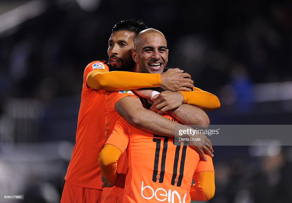 Zakaria Bakkali (#11) of Valencia CF is congratulated byAymen Abdennour (C) and Ezequiel Garay after scoring his team's 3rd goal during the Copa del Rey Round of 32 match between CD Leganes and Valencia CF at Estadio Municipal de Butarque on November 29, 2016 in Leganes, Spain.