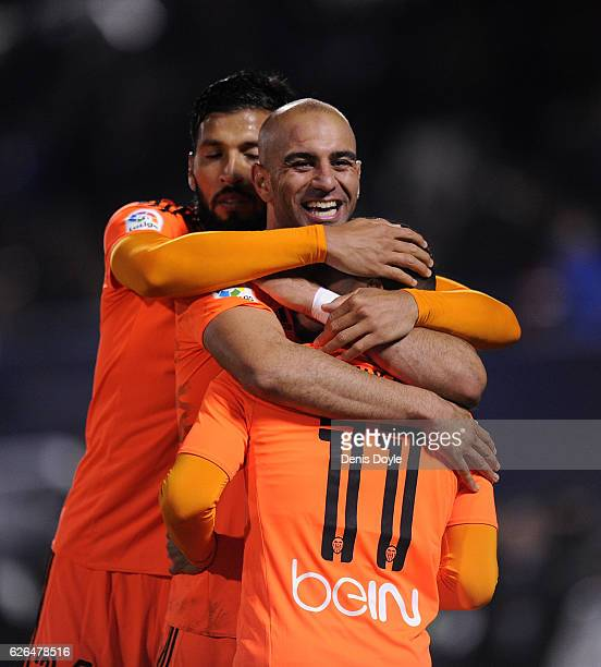 Zakaria Bakkali of Valencia CF is congratulated byAymen Abdennour and Ezequiel Garay after scoring his team's 3rd goal during the Copa del Rey Round...