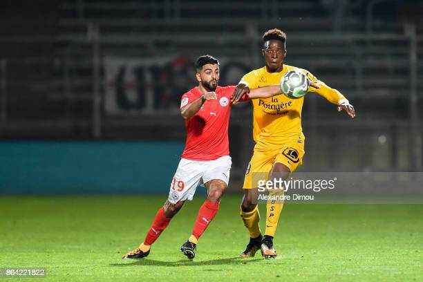 Zakaria Diallo of Brest and Umut Bozok of Nimes during the Ligue 2 match between Nimes Olympique and Stade Brestois at on October 20 2017 in Nimes...