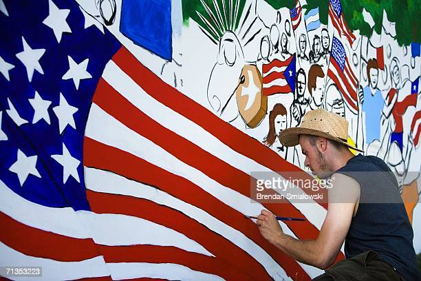 Zaki Ghul a graphic designer works on painting in a mural by Gamaliel Ramirez during the 2006 Smithsonian Folklife Festival on the National Mall July...