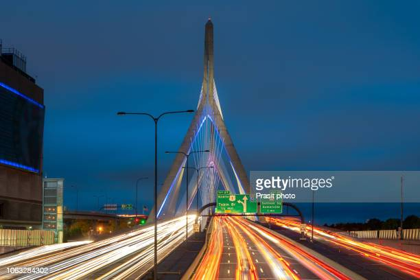 zakim bunker hill memorial bridge with car light traffic at night in boston, massachusetts, usa. - boston stock pictures, royalty-free photos & images