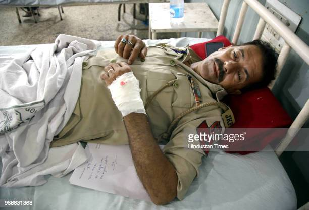 Zakir Hussain a police constable who was injured during the shelling from the Pakistani side undergoes treatment at the medical college hospital on...