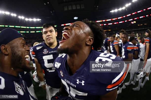 Zakoby McClain of the Auburn Tigers celebrates a 2721 win against the Oregon Ducks during the Advocare Classic at ATT Stadium on August 31 2019 in...