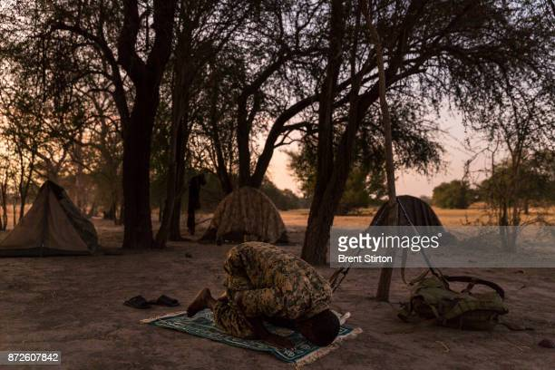 Zakouma Rangers 'Mamba Team 1' seen inside the park during one of their antipoaching patrols Driver Issa Idriss Adoum wearing the brown shirt lost...