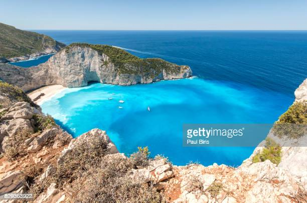 zakynthos, greek islands. elevated view of famous navagio shipwreck beach - mediterranean sea stock pictures, royalty-free photos & images