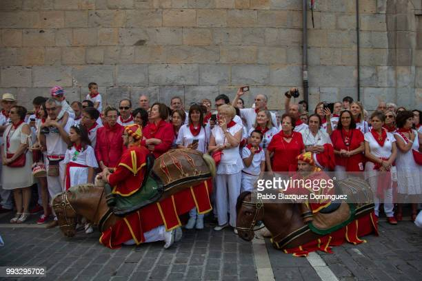 'Zaldikos' rests was they wait during the Comparsa de Gigantes y Cabezudos or Giants and Big Heads parade on the second day of the San Fermin Running...