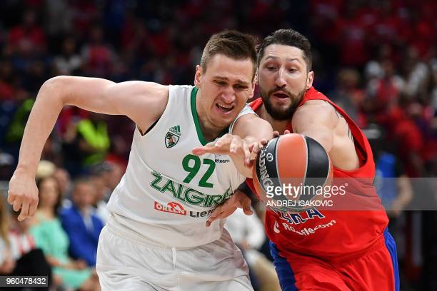 TOPSHOT Zalgiris' Lithuanian forward Edgaras Ulanovas fights for the ball against CSKA's Russian forward Nikita Kurbanov during the Euroleague Final...