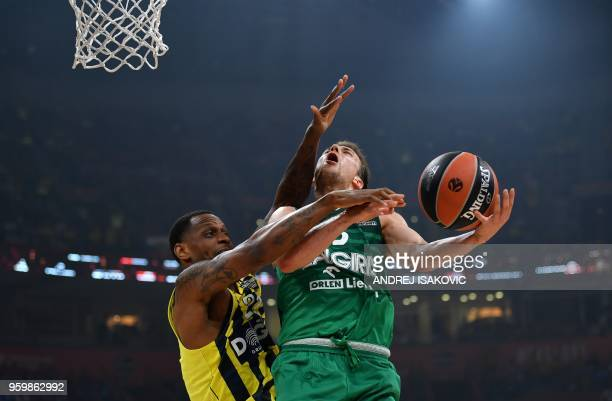 Zalgiris' Slovenian guard Kevin Pangos and Fenerbahce's US forward James Nunnally during the first semifinal EuroLeague Final Four basketball match...