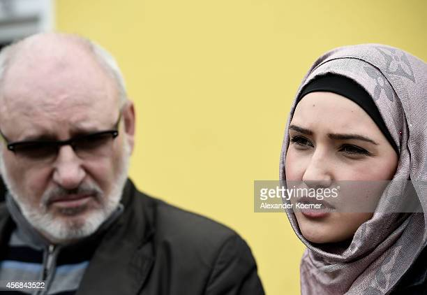 Zaliakan Kharatschov and his daughter Sulidian Kharatschonwa of the Chechen commnunity of Celle talk to members of the press in front of the Yazidi...
