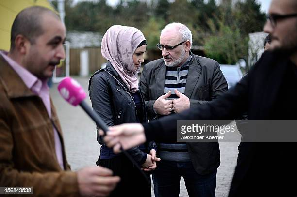 Zaliakan Kharatschov and his daughter Sulidian Kharatschonwa of the Chechen commnunity of Celle are pictued during a talk to the press in front of...